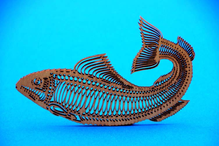 A fish which is highly detailed design that has been cut  to shape with a  laser.