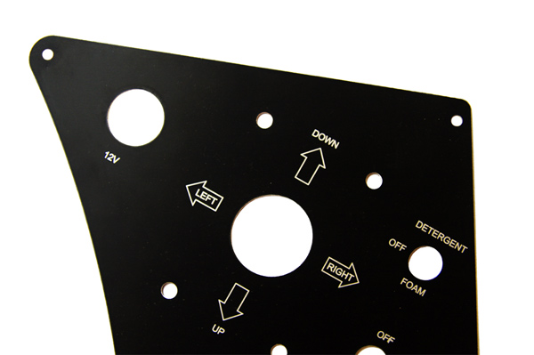 Coated aluminium control panel that has been laser cut and laser engraved.