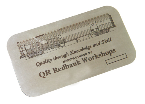 A stainless steel nameplate laser engraved with wording and a image.